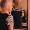 Photo of woman standing in front of mirror 2269726