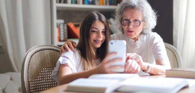 Photo of woman showing her cellphone to her grandmother 3768140