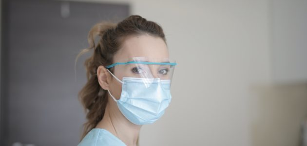 Woman in blue shirt wearing face mask 3881247