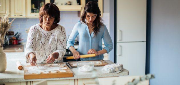 Women making dumplings in the kitchen 3893527