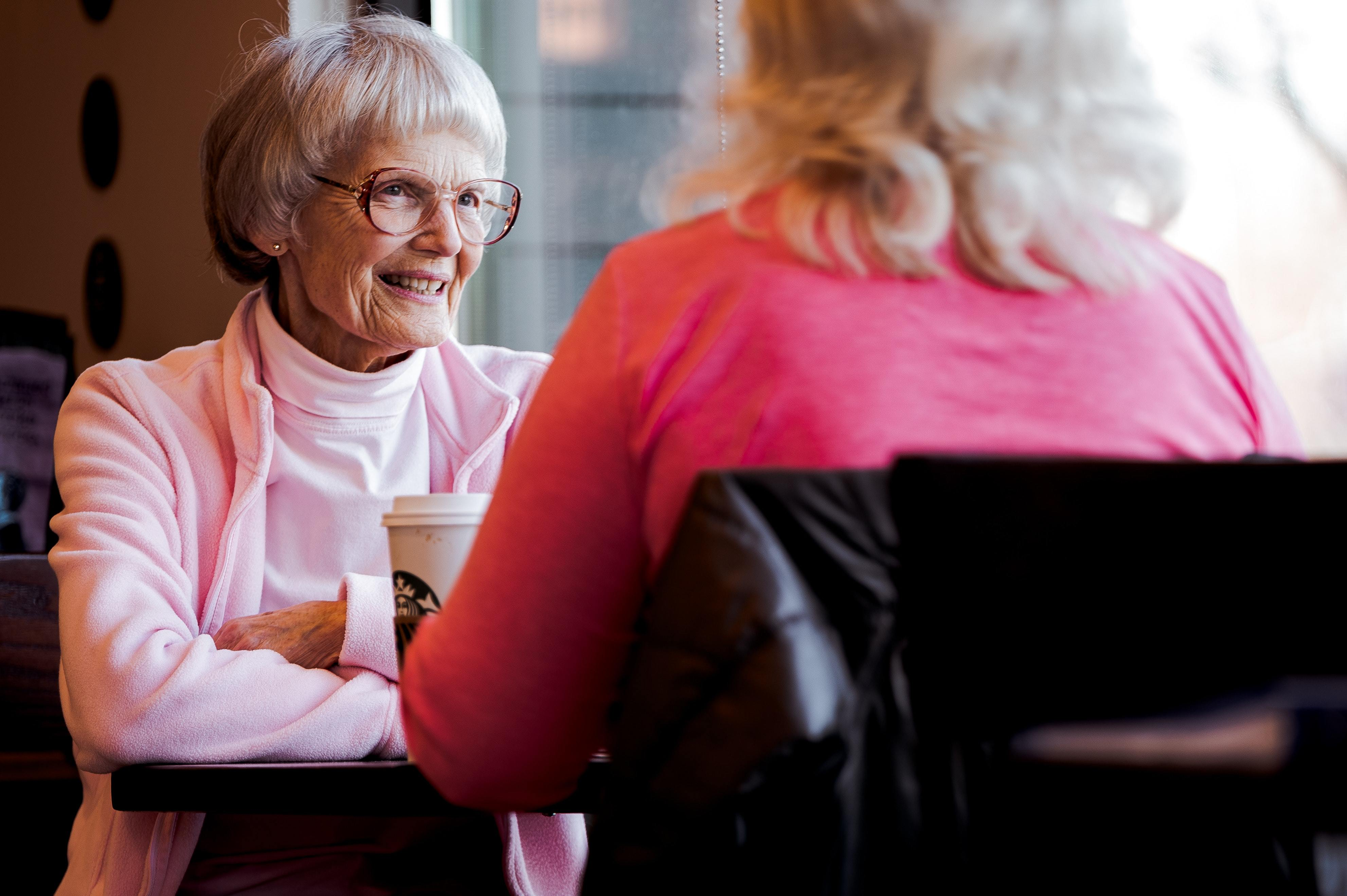 Photo of old woman sitting while talking with another woman 3729182